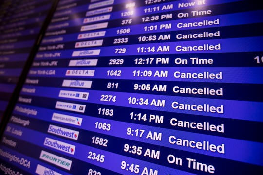 A flight information board at Southwest Florida International Airport displays cancelled flights  on Thursday March, 26, 2020.  Screeners from the Department of Health are giving certificates to travelers from the Tri state area to fill out.