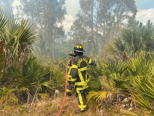 Lehigh Acres Fire Control and Rescue District respond to brush fire Thursday at 61 Street West and Susan Avenue.  61 St