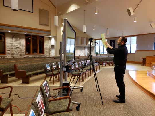 Rev. Andy Behrendt of Trinity Lutheran Church, Waupaca, records a children's sermon on March 25, 2020. Parents provided photos of the children for the virtual church sermon.