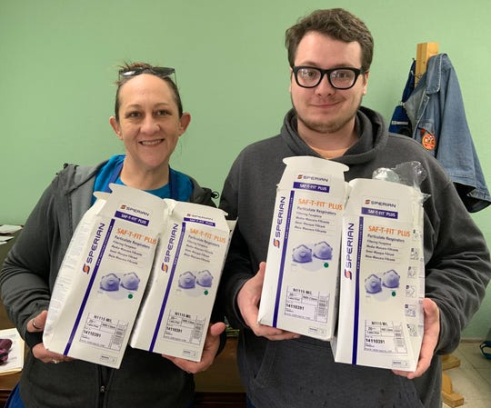 Heather Thyrion and James Champion show off the masks being donated to Door County Medical Center.  Door County Habitat for Humanity reports they quickly returned to their standard 6-foot separation after the photo was taken.