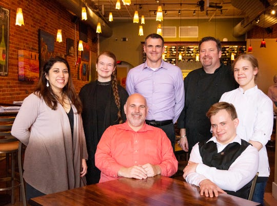 SELECT owner Jeff Gossett, middle, with members of his staff at the downtown Greer restaurant.