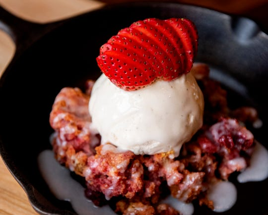 The Strawberry Pandowdy- fresh strawberries baked with sweet dough and whole cream.  Served with vanilla bean ice cream, finished with light crème.