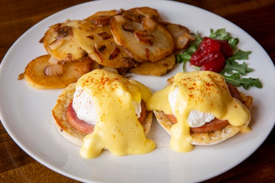 Eggs Benedict with flat iron potatoes and cinnamon candied apples.