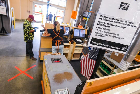 """A red """"X"""" marks serve as reminders for customers of the six feet of space needed during the practice of social distancing at The Home Depot store in Tamuning in this March 26 file photo."""