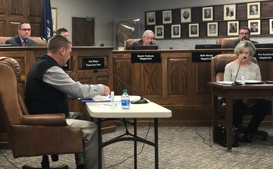 The Henderson County Fiscal Court has adjusted seating arrangements during the global pandemic involving COVID-19. Magistrates Keith Berry and Beth Moran were moved to individual tables due to social distancing recommendations  (March 24, 2020).