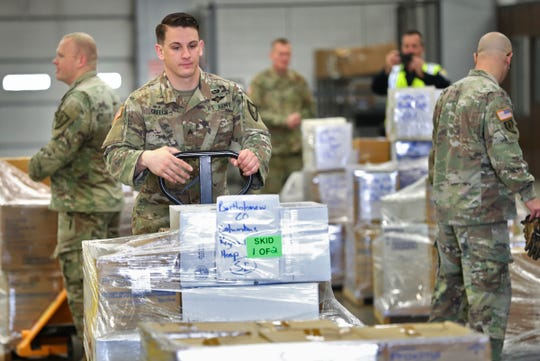 Medical supplies are loaded at the Indiana National Guard's Stout Field, Thursday, March 26, 2020, to deliver to hospitals throughout Indiana. The Indiana National Guard, Indiana Department of Transportation and Indiana State Police came together in this multi-agency distribution of urgently-needed medical supplies.