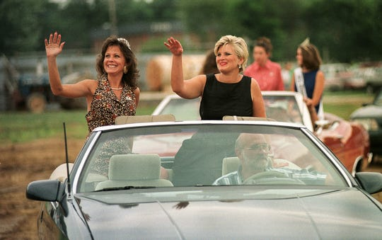 Mimi Pearce (right), the 1982 Morgan County Fair Queen, is shown in a parade in 1999 for the 50th anniversary celebration at the Morgan County Fair.