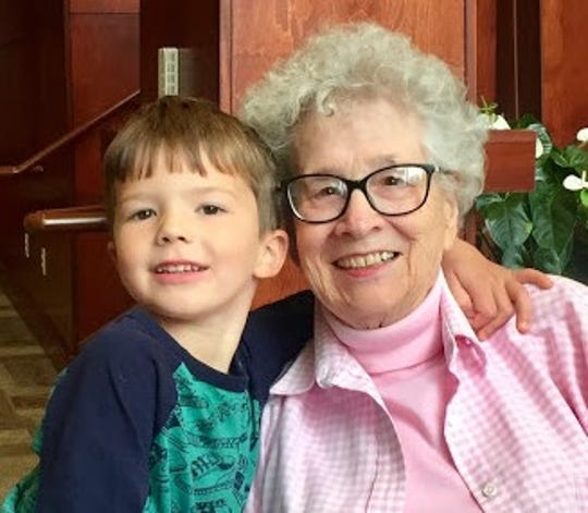 Oaknoll residents such as Marilou Gay are making the best of being cooped up in their living quarters with little contact from friends or family. In this photo, she poses with one of her grandsons, Graham.