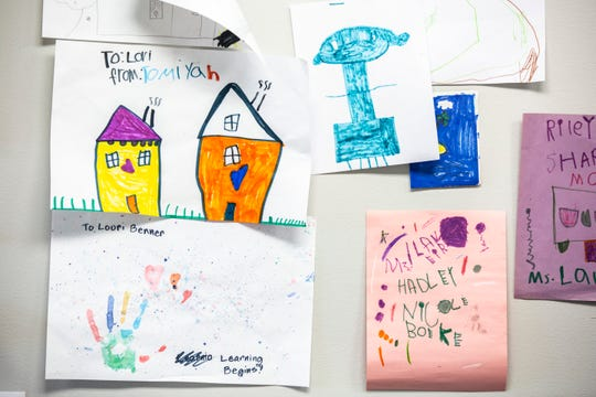 Drawings from kids hang up at the Learning Begins Child Development Home, Thursday, March 26, 2020, in North Liberty, Iowa.