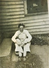 Loretta Angerer, said to be wearing her brotherÕs bib overalls, appears at age 16 in this snapshot taken at her Iowa City home in the late 1930s. She says the Great Depression was even tougher on people with no resources, like the transient men from the railroad who were never turned away from her motherÕs kitchen.