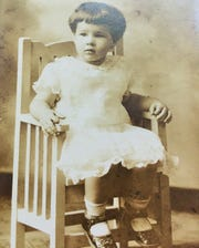 Marilou Gay posed for this classic photo at age two during the start of the Great Depression. She said she was hospitalized two years later with pneumonia and the resulting medical bills came close to putting her family's Iowa City dairy farm out of business during those tough times.