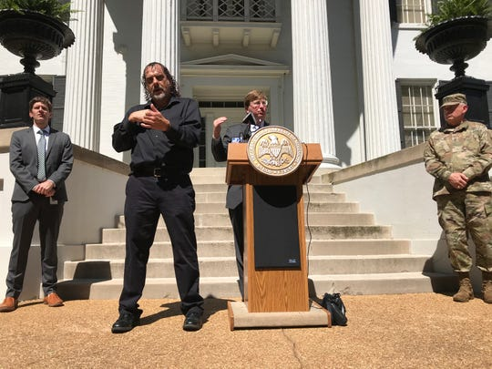 Gov. Tate Reeves holds a news conference in front of the Governor's Mansion on Thursday, March 26, 2020.