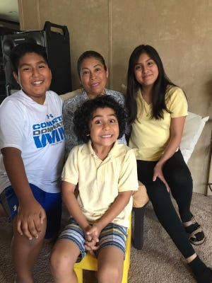 Francisca Morales Diaz (center), of Laurel, was detained by immigration officials after the workplace raids on Mississippi chicken processing plants in August. She was released on Friday March 20 and reunited with family members.