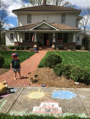 The Long family's artistic renderings wouldn't be complete without a picture of their house in chalk! Everett and Henry (on porch) think that's pretty cool. March 25, 2020.