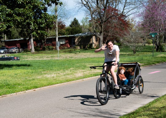 Residents take a bike ride on the greenway in Sequoyah Hills.