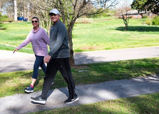 Tennessee head basketball coach Rick Barnes and Candy Barnes walk on Thursday, March 26, 2020, on the greenway in Sequoyah Hills.