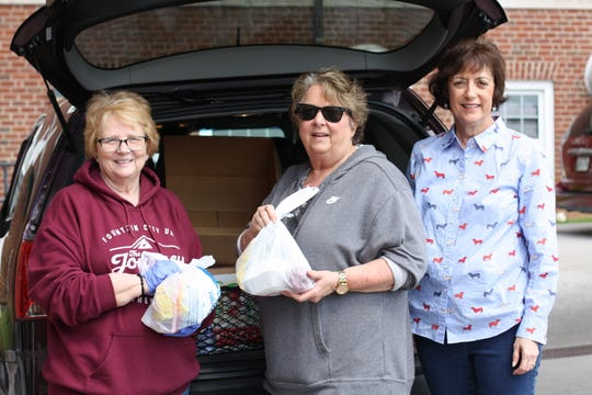 Donna Lewis, Debbie Pickett and Liz Brown from Fountain City United Methodist Church bagged up lunches made from food they had in their church fridge – sandwich, chips and fruit. They filled the trunk of their car and happily handed them out to people in need as they pulled into the parking lot of the Central Baptist Church. March 25, 2020.