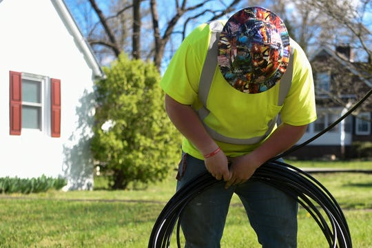 Austin Davidson works with fiber-optic cables for broadband internet near Carson-Newman  University in Jefferson City, Tenn., on Thursday, March 26, 2020.