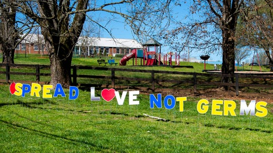 """""""Spread love not germs"""" sign outside of Bluegrass Elementary School in West Knoxville on Thursday, March 26, 2020."""