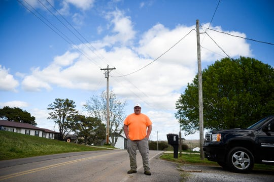 Chad Chambers of New Market, Tenn., stands at the end of his driveway on Nances Ferry Road on Wednesday, March 25, 2020. Chambers, along with much of the New Market community, does not have access to broadband internet.