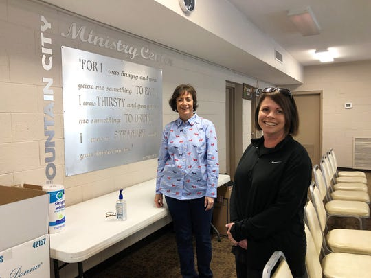 Fountain City Ministry Center operations manager Kelly Gregory, right, with Liz Brown, who volunteers at the center on Tuesdays. At the moment, the inside of the center is closed to everyone apart from volunteers. March 25, 2020.
