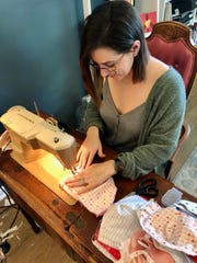 Katie Sellers sews homemade facemasks to donate to local hospitals amid the coronavirus outbreak.