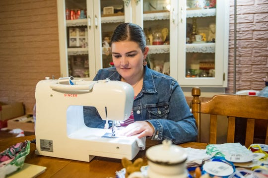 Christine Savoie sewing a face mask in her home to donate to medical staff. Wednesday, March 25, 2020.