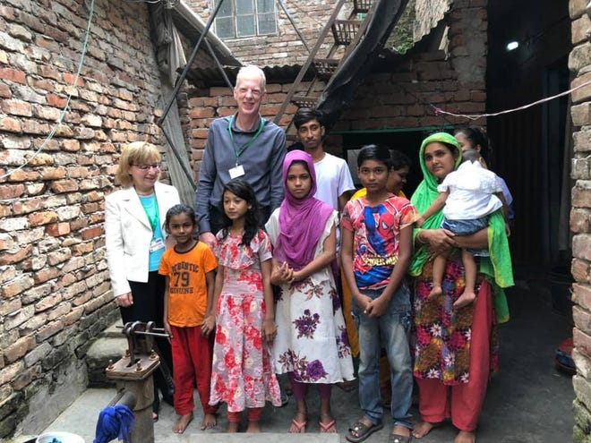 Daniel Hartman, center, pictured with a family in Bangladesh in October of 2019. Hartman, a former Michigan pulmonary critical care doctor,  is working to determine which existing drugs can be used to treat the coronavirus on behalf of the Bill and Melinda Gates Foundation.