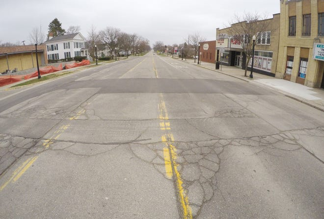 Mid-day on a weekday in downtown Howell normally shows much more traffic than is seen Thursday, March 26, 2020 as people stay at home and businesses are closed.
