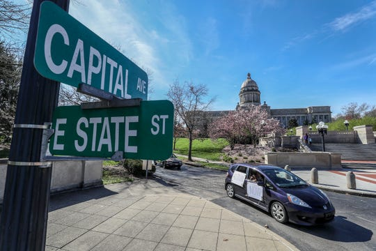 Save Kentucky Democracy Coalition members circulate the Kentucky state Capitol in vehicles honking their horns, Thursday, Mar 26, 2020, in Frankfort.  The group wants the Kentucky General Assembly to stop meeting when the public is unable to be part of the legislative process.