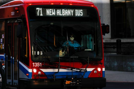A TARC driver wearing a mask heads to New Albany. March 25, 2020.