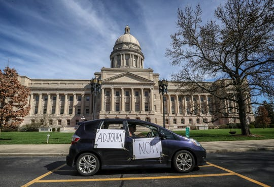 Save Kentucky Democracy Coalition members circulate the Kentucky state Capitol in vehicles honking their horns on Thursday. The group wants the Kentucky General Assembly to stop meeting when the public is unable to be part of the legislative process.