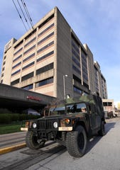 Kentucky National Guardsman Sgt. Daniel Smith sits in his vehicle outside University of Louisville Hospital on Thursday.