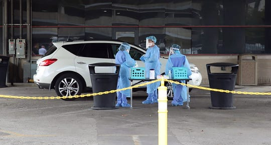 The University of Louisville Health system launcheda drive-through coronavirus test site at a downtown parking lot Thursday to screen high-risk patients atthe corner of Brook and Liberty streets downtown. March 26, 2020