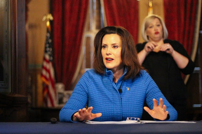Gov. Gretchen Whitmer updates Michigan residents on the state's response to the coronavirus pandemic at the Capitol on March 26, 2020.