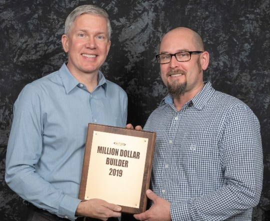 Chris Herzog (right) from Manitowoc's A.C.E. Building Service recently attended the 2020 Butler Builder Meeting in Austin, Texas, where the company was named a Million Dollar Builder for 2019.