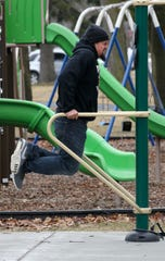 Trey Estrada of Manitowoc gets in a bit of exercise at Washington Park, Thursday, March 26, 2020, in Manitowoc, Wis.