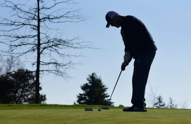 Scott Carr, of Galion, makes a putt Wednesday evening at Valley View Golf Course.