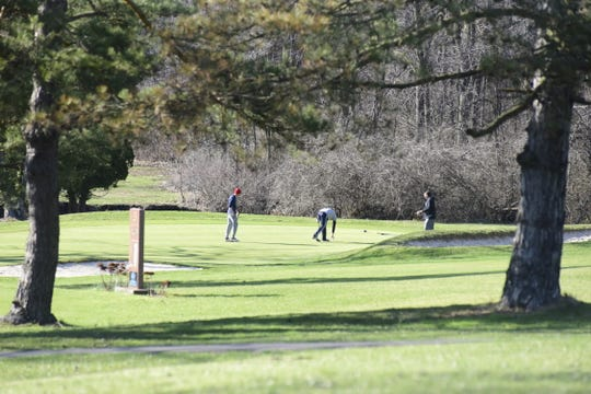 A group of golfers finish the third hole Wednesday evening at Valley View Golf Course in Galion.