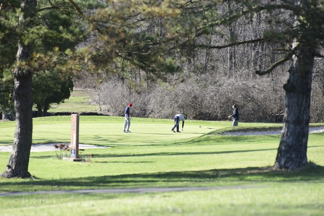 A group of golfers finish the third hole this spring at Valley View Golf Course in Galion.
