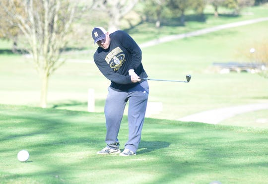 Scott Carr, a Galion resident who coaches wrestling at Northmor High School, tees off Wednesday evening at Valley View Golf Course.