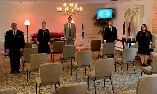 Funeral directors, from left, J. Todd Snyder, Susan Dill, Sean Snyder, Gideon Snyder and Hannah Snyder Werneck stand amid chairs spaced to allow social-distancing for services at Snyder Funeral Home on Lexington Avenue. The staff is working to apply new protocols to funeral services amid the COVID-19 crisis.