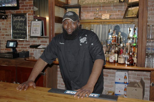 Co-owner Chris Rennick said sales have been cut in half at Attaboy's Comfort Cuisine in downtown Marion since the state ordered all restaurant dining rooms to close due to the coronavirus outbreak.