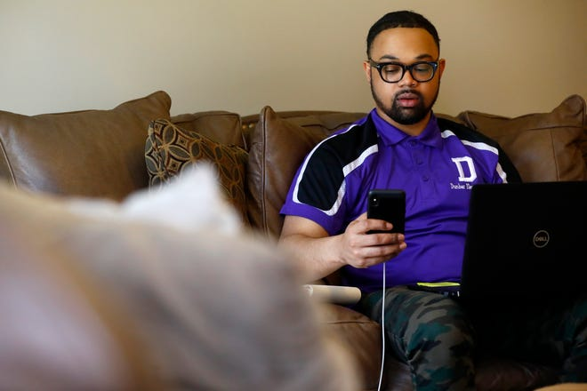 "Brian Ingram, a first year principal at Dunbar Elementary School in Orange Mound, is working virtually from home to create instruction plans and interact with his students and teachers on Thursday, March 26, 2020. ""If they don't have a tablet, or don't have a laptop— 95 percent of my kids have a smart phone. So now my job now is charging my staff to look at options that can be utilized on a smart phone,"" said Ingram."