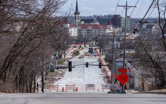 "Road construction continues on Northwest Barstow Street in Waukesha on Wednesday, March 25, 2020. Major construction projects are exempt from the ""Safer At Home"" issued by Gov. Tony Evers that mandates all nonessential businesses around the state to close during the pandemic."