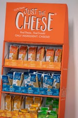 Just The Cheese snack products are shown Thursday, March 26, 2020, at the Specialty Cheese Co. Inc. in Reeseville, Wis. The Dodge County cheese maker has been swamped with orders for shelf-stable cheese snacks such as these crunchy toasted cheese snacks.