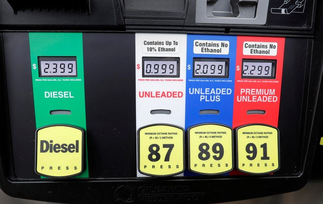 Jacob Praska, Delavan,  was pleased with the price he paid to fill his tank at Fleet Farm in Delavan, Wisconsin, near I-43  and Highway 50, which is selling gasoline for .99 per gallon as gas prices drop during the coronavirus pandemic, Thursday March 26, 2020.  Rick Wood/Milwaukee Journal Sentinel ORG XMIT: 30100109A