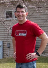 "Rick Petfalski wears a ""Muskego Strong"" T-shirt."
