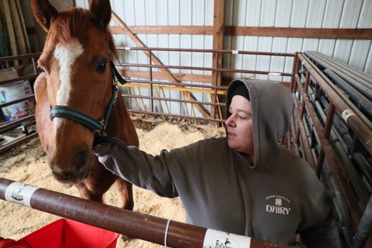Monica Gahan tends to the horse named Winnie on the farm. Gahan, the animal science pathway teacher at Vincent High School in Milwaukee, is taking care of the animals at the small farm that the school runs on campus.