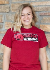 """Muskego High School student Faith Kierzek wears a """"Muskego Strong"""" T-shirt. As president of her school's Future Business Leaders of America chapter, she is helping lead an effort to sell shirts with the words """"Muskego Strong"""" on them to benefit local businesses and community members in need."""